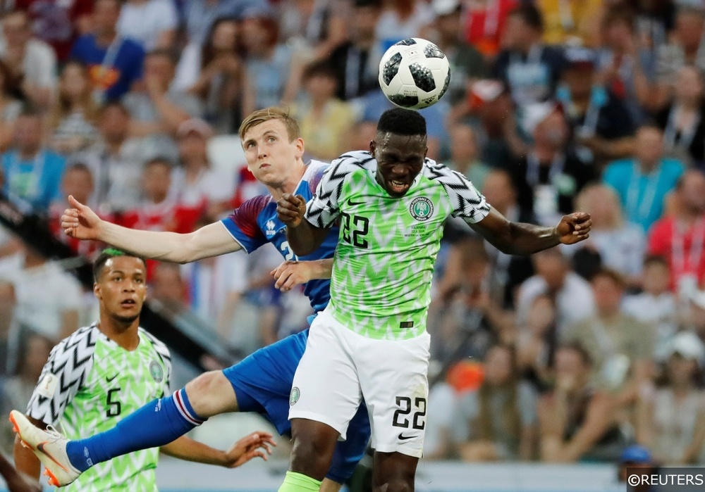 Kenneth Omeruo wins a header for Nigeria against Iceland