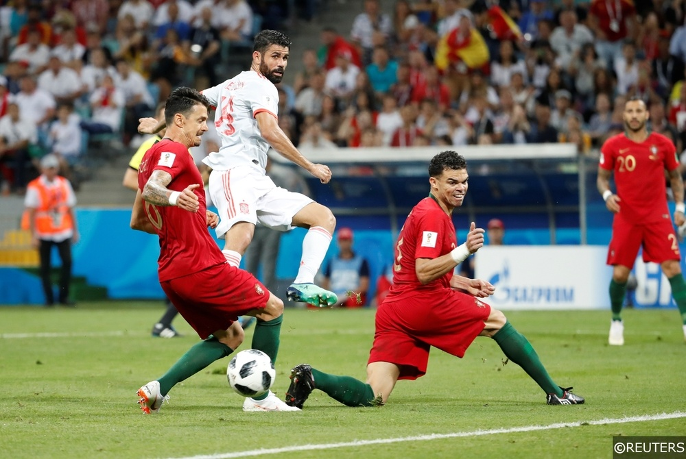 Pepe defending for Portugal against Spain at the World Cup