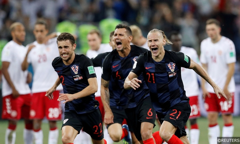 Ekspresi pemian Kroasia yang begitu tegang meluapkan kegembiraannya saat berhasil menumbangkan Rusia di perempat final.