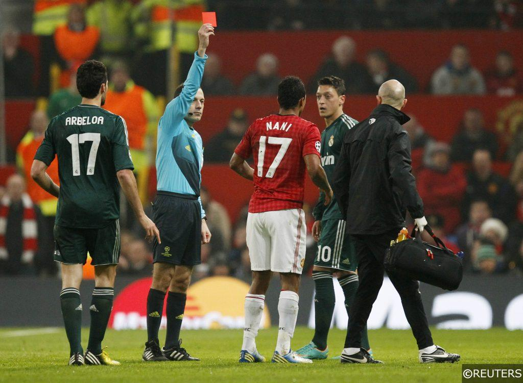 Cuneyt Cakir sends off Nani in the Champions League