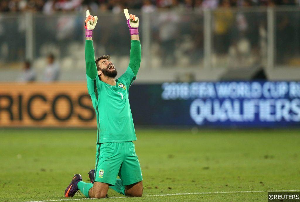 Alisson celebrates a win for Brazil