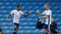 Bury's Neil Danns celebrates scoring their first goal.