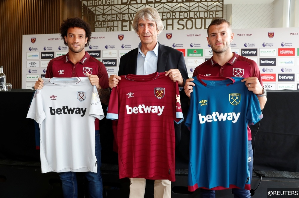 West Ham manger Manuel Pellegrini with Felipe Anderson and Jack Wilshere