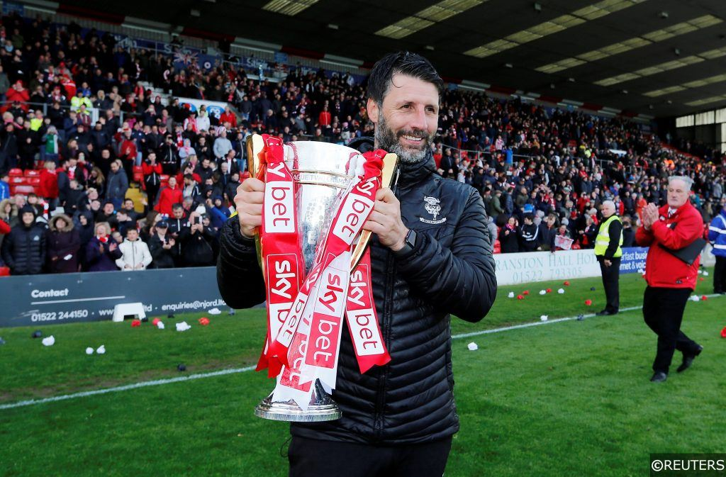 Danny Cowley lifts League Two trophy after going up as champions.