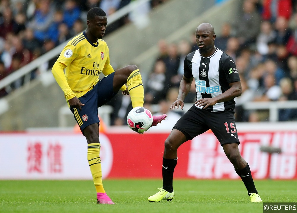 Arsenal's Nicolas Pepe controls the ball away to Newcastle