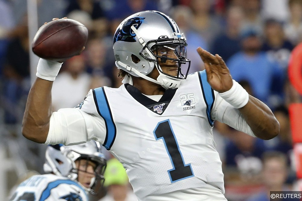 Cam Newton Throwing A Football For The Carolina Panthers