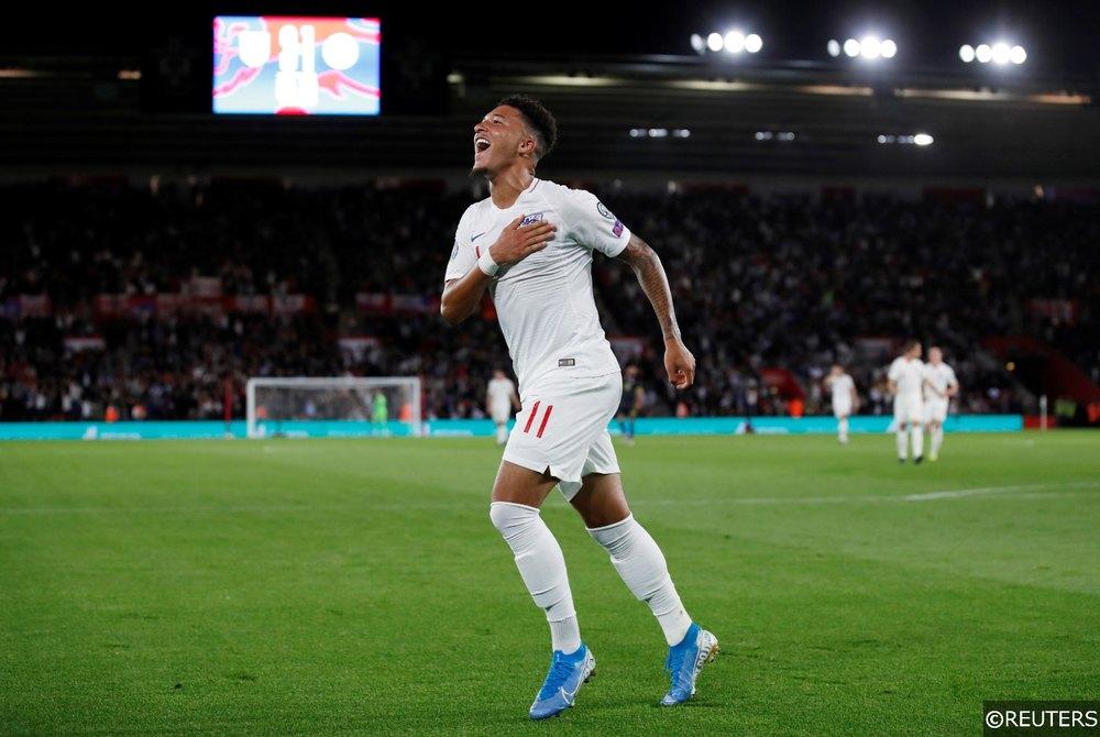 Jadon Sancho celebrates scoring his first goal for England