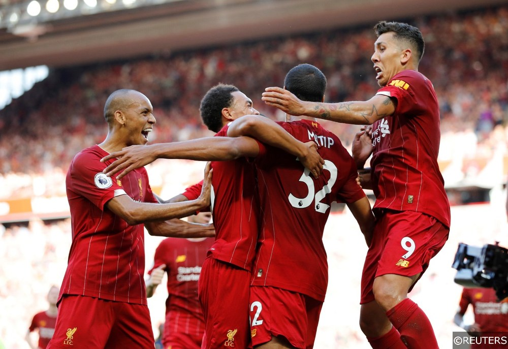 Fabinho and Firmino celebrate with Matip after goal vs Arsenal