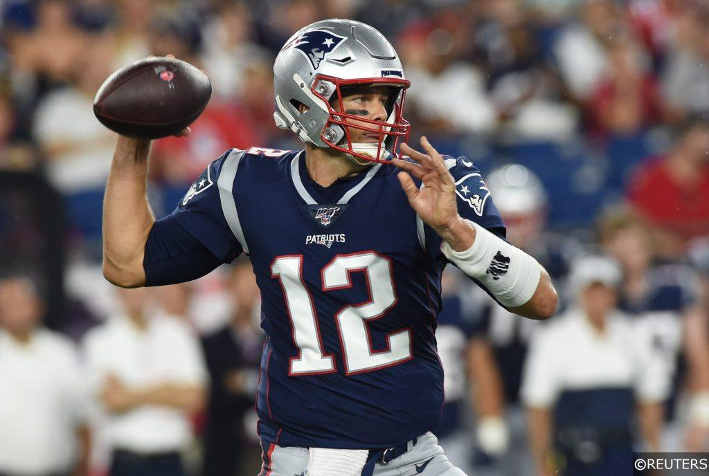 Tom Brady playing quarterback for the New England Patriots
