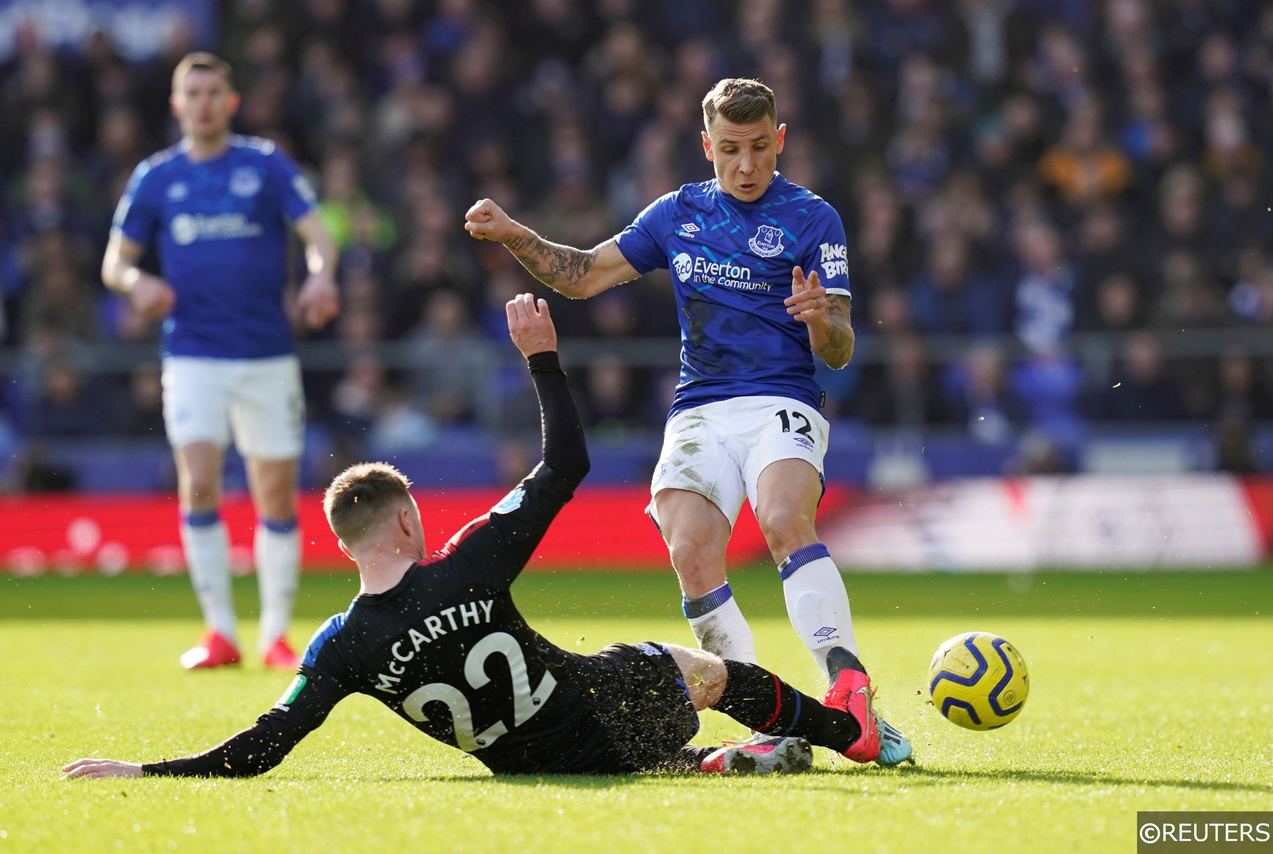 Everton defender Lucas Digne tackled