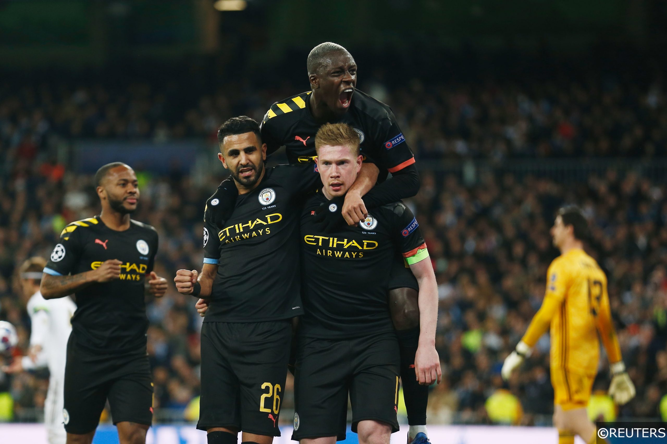 Manchester City players celebrate a goal in the Champions League